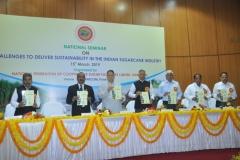 (From Left to Right)-Dr. A.D.Pathak, Director ICAR-IISR, Lucknow; Dr. R.K.Singh, ADG (Commercial Crops), ICAR; Shri Dilip Walse Patil, President, NFCSF; Prof. Vijay Paul Sharma, Chairman, CACP; Dr. Bakshi Ram, Director, ICAR-SBI, Coimbatore; Shri J. Dandegaonkar, Director, NFCSF and Shri Vikas Deshmukh, Director, VSI, Pune.