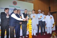 Dignitaries lighting the lamp to inaugurate the seminar