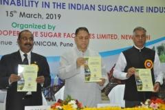 Dignitaries while releasing a souvenir during the National Seminar