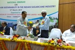 Shri Dilip Walse Patil, President, NFCSF giving away Lifetime Achievement Award to Dr. Bakshi Ram, Director, ICAR-SBI, Coimbatore