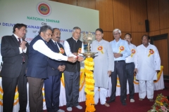 Dignitaries lighting the lamp to inaugurate the seminar